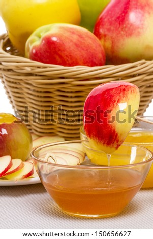 Apples (different varieties) and honey, symbols of the Jewish new year - stock photo