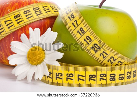 Apples, flower and measuring tape. Concept of healthy food. - stock photo