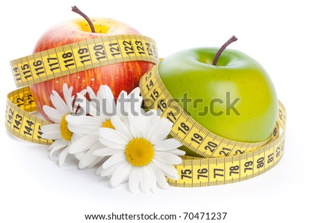 Apples, flowers and measuring tape. Concept of healthy food. - stock photo