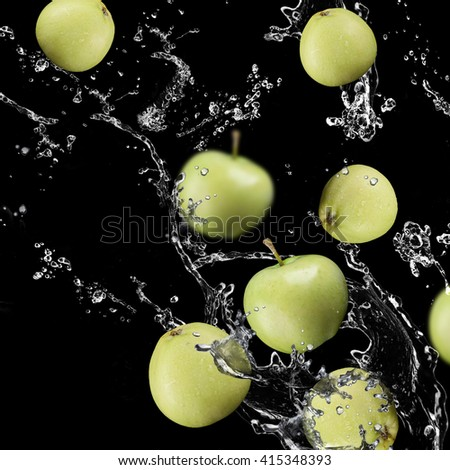 apples fruits and Splashing water - stock photo