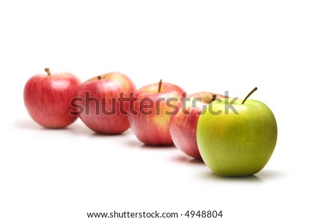 Apples in a row, green leading - stock photo