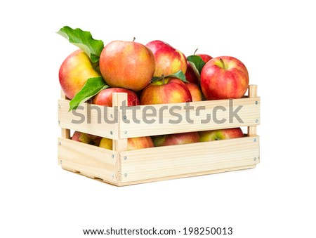 Apples in a wooden box isolated on white background - stock photo