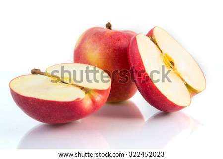 Apples in half lengthwise. - stock photo