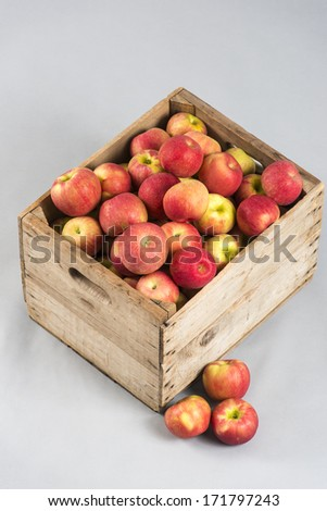 Apples in wooden crate - stock photo