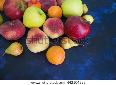 Apples, peaches and pears on a dark background - stock photo