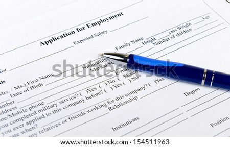 application form for employment with pen - stock photo