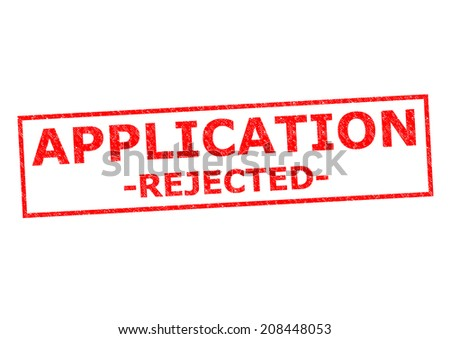 APPLICATION REJECTED red Rubber Stamp over a white background. - stock photo