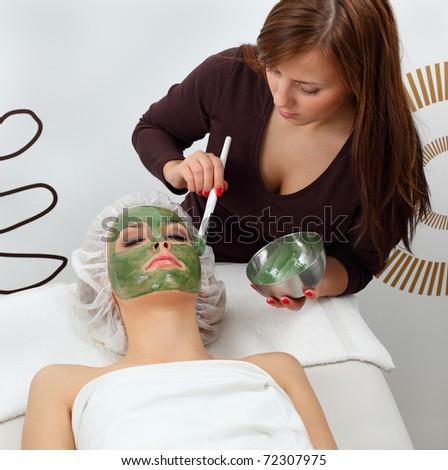 Application seaweed mask in professional studio - stock photo