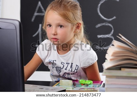 applied behind the school desk - stock photo
