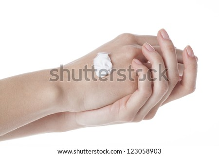 Applying cream to hands, isolated white background - stock photo