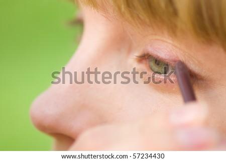 Applying eyeliner - stock photo