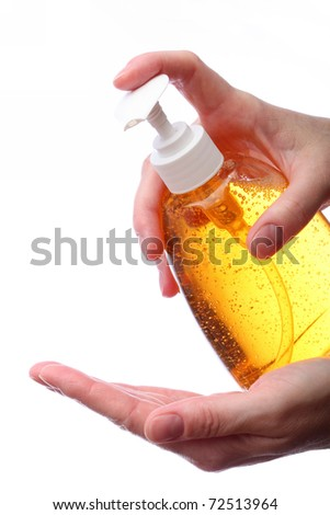 Applying liquid soap. Two hands holding bottle with liquid soap isolated on white background. - stock photo
