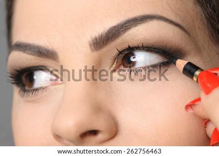 Applying perfect makeup - stock photo