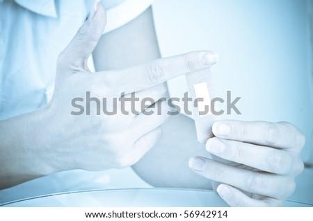 applying plaster on an arm - stock photo