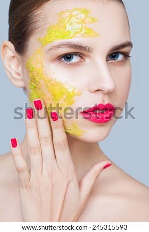 Applying scrub - stock photo
