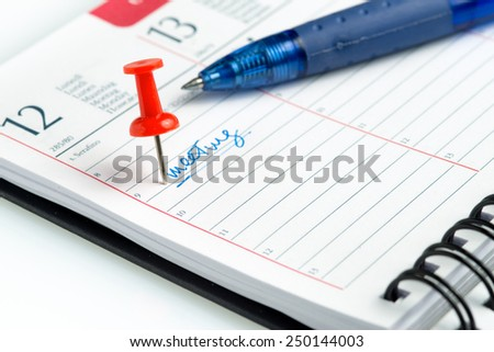 appointment written on a weekly agenda  - stock photo