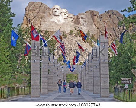 Approach concourse to to the Mt. Rushmore National Memorial, Keystone, South Dakota showing the flags of the States - stock photo