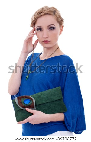 Approachable woman holding purse and necklace against white background - stock photo