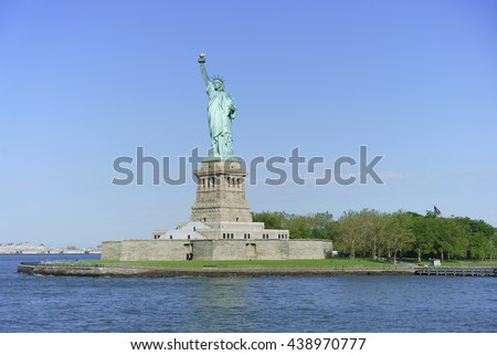 Approaching Liberty Island from Battery Park in New York City - stock photo