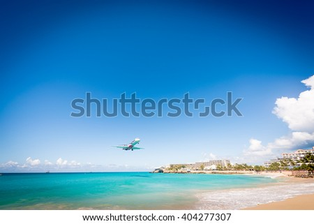 Approaching plane at SXM airport in St Martin - stock photo