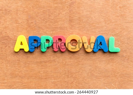 approval colorful word on the wooden background - stock photo