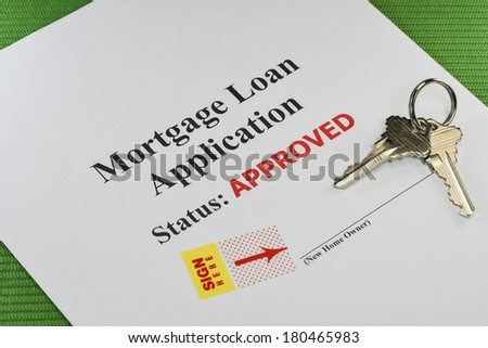 Approved Real Estate Mortgage Loan Document Ready For Signature With House Keys - stock photo