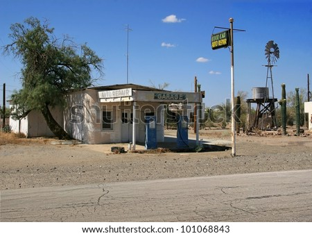 Approx. 30 photographs were merged to create a great looking vintage service station,water tower,blue colored gas pumps and white adobe style buildings./  Vintage Auto Repair Shop / Very cool ! - stock photo