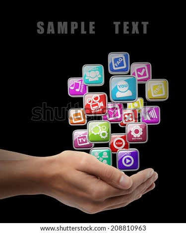 APPS icons. Man hand holding object isolated on black background. High resolution  - stock photo
