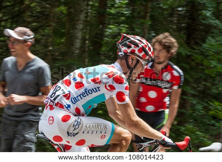APREMONT,FRANCE,JUL 13:The cyclist  Fredrik Kessiakoff(Astana Pro Team) wearing Polka-Dot Jersey while climbing the road to mountain pass Granier in the stage 12 of Le Tour de France on July 13 2012. - stock photo