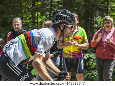 APREMONT,FRANCE-JULY 13 :The Cyclist Mark Cavendish, climbing the last kilometers of the road to Col du Granier in the Alps during the stage 12 of Le Tour de France in Apremont on 13 July 2012. - stock photo