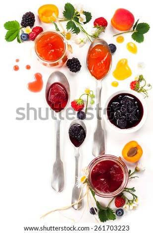 Apricot ,blackberry and strawberry jam on white background - stock photo