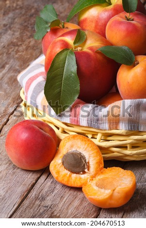apricot halves closeup on background baskets of fruit on the table. vertical  - stock photo
