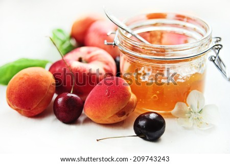 apricot jam and fresh fruits - stock photo