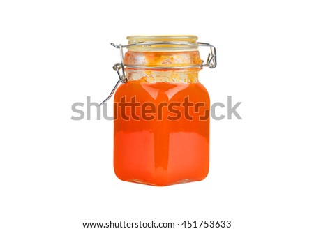 Apricot jam in glass jar, isolated on white background - stock photo