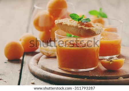 Apricot jam with bread, selective focus and toned image - stock photo