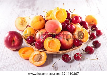 apricot with cherry and peach - stock photo