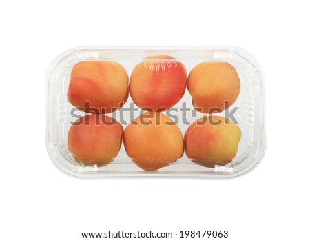 Apricots in plastic package / box  isolated - stock photo