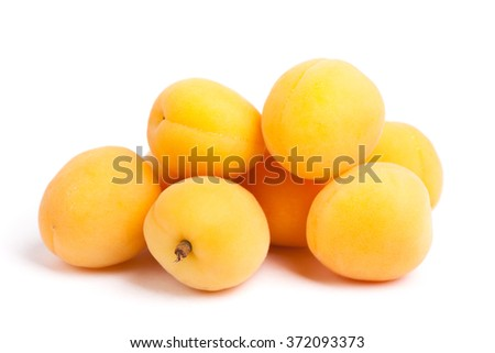 Apricots isolated on white background - stock photo
