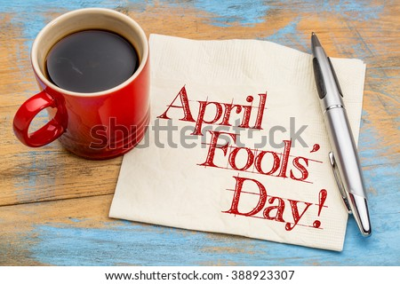 April Fools' Day! Handwriting on a napkin with a cup of coffee - stock photo
