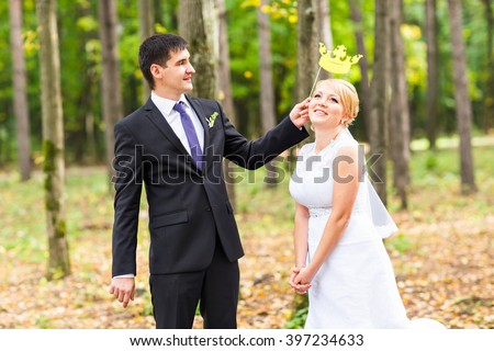 April Fools' Day. Wedding couple posing with stick lips, mask. - stock photo
