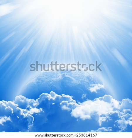 April 22 International Mother Earth Day, blue planet Earth in white clouds, bright sunlight from above. Elements of this image furnished by NASA nasa.gov - stock photo