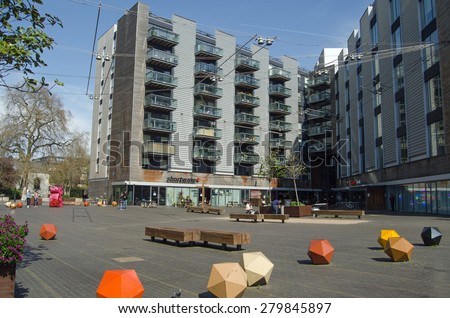 APRIL 12, 2015:  People enjoying the spring sunshine in April at Bermondsey Square in urban Southwark, South London.  The area has recently become popular with hipsters. - stock photo