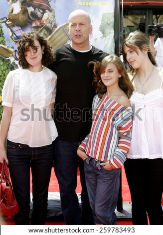 """April 30, 2006. Rumer Willis, Tallulah Belle Willis, Bruce Willis and Scout Larue Willis at the Los Angeles Premiere of DreamWorks' """"Over The Hedge"""" held at the Mann Village Theatre in Westwood.  - stock photo"""