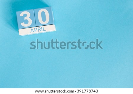 April 30th. Image of april 30 wooden color calendar on blue background.  End month. Spring day, empty space for text. International Jazz Day - stock photo