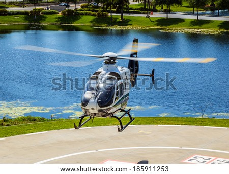 April 4th, 2014 Tampa Florida Bayflite Helicopter. Bayflite is a rescue helicopter that responds to Trauma rescue scenes and transports patients to the hospital trauma center. - stock photo