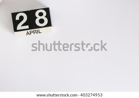 April 28th. Tax Day. Image of april 28 wooden color calendar on white background.  Spring day, empty space for text - stock photo