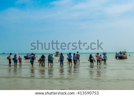 April 14 ,2016 - Travelers waiting for their boats to cross island ,Pranburi ,Thailand - stock photo