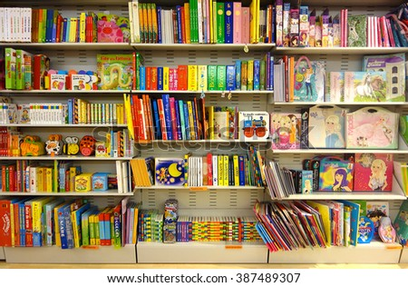 Aprilia, Italy: Circa Aug 2013 - Shelf full of colorful children fairy books in bookshop at Aprilia2 Mall, Rome, Italy    - stock photo