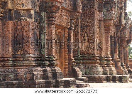 Apsara dancer on walls of intricate temple at  Banteay Srei, Cambodia - stock photo