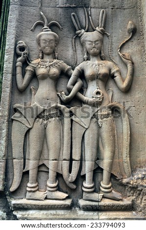 Apsara Dancers Stone Carving all around on the wall at Angkor wat, Siemreap, Cambodia - stock photo